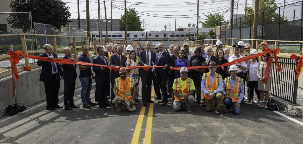 MTA Chief Development Officer Janno Lieber cuts the ribbon in a ceremony at Urban Avenue, marking the reopening of the roadway that now travels under the LIRR main line, the first of eight grade crossing eliminations to be completed as part of the $2.6 billion LIRR Expansion Project.